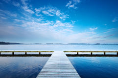 Duality. A symmetric jetty dividing up in two directions, make a choice go left or right Stock Photos