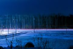 The Duality Of Winter Nights. A long exposure shot showcasing the positivity and negativity of winter utilizing light and shadows Royalty Free Stock Images