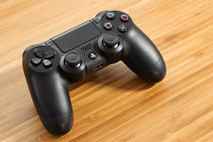 DualShock 4. UFA, RUSSIA - 26 JUNE, 2016: The new Sony Dualshock 4 is on the table. Sony PlayStation 4 game console of the eighth generation Stock Image