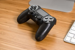 DualShock 4. UFA, RUSSIA - 26 JUNE, 2016: The new Sony Dualshock 4 is on the table. Sony PlayStation 4 game console of the eighth generation stock photo