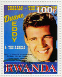 Duane Eddy American guitarist. Stamp printed in Rwanda shows Duane Eddy is an Grammy Award-winning American guitarist  , circa 2003 Royalty Free Stock Image