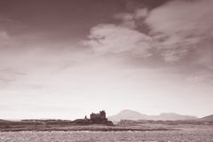 Duart Castle on the Isle of Mull, Scotland. In Black and White Sepia Tone Stock Image
