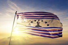 Duarte Province of Dominican Republic flag textile cloth fabric waving on the top sunrise mist fog. Beautiful royalty free stock photos