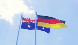 Duas bandeiras que acenam contra o céu azul ilustração stock