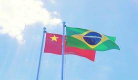 Duas bandeiras que acenam contra o céu azul ilustração royalty free