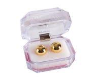 Duas bolas douradas do amor na caixa plástica Imagens de Stock Royalty Free