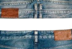 Duas calças de brim, no fundo branco imagens de stock royalty free