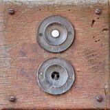 Duas campainhas, uma quebrada e coberta nas teias de aranha Foto de Stock Royalty Free