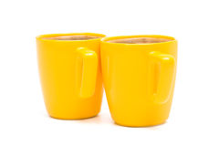Duas canecas amarelas Fotos de Stock