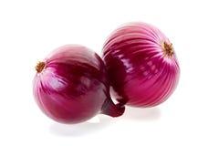 Duas cebolas vermelhas no branco Fotografia de Stock