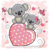 Duas coalas estão sentando-se em um coração ilustração stock