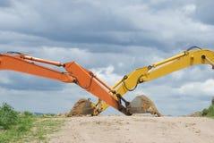 Duas colheres da máquina escavadora Foto de Stock Royalty Free