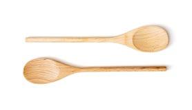 Duas colheres de madeira no fundo branco Imagens de Stock Royalty Free