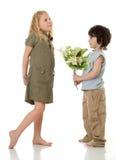 Duas crianças com flores fotos de stock royalty free
