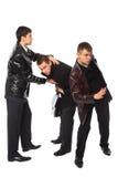 Duas escoltas protegem o homem de negócios imagem de stock
