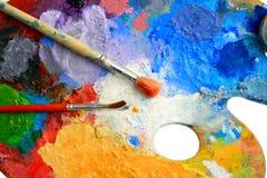 Duas escovas colocam em uma paleta da arte Imagens de Stock Royalty Free