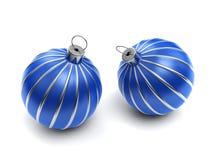 Duas esferas listradas azuis do Natal Fotos de Stock