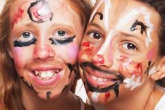 Duas faces pintadas Fotos de Stock Royalty Free