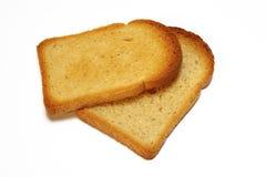 Duas fatias de pão brindado no fundo branco Imagens de Stock Royalty Free