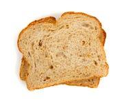 Duas fatias de pão inteiro da grão no branco imagens de stock