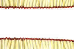 Duas fileiras dos fósforos com as cabeças vermelhas isoladas no fundo branco Fotos de Stock Royalty Free