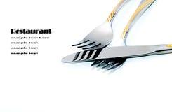 Duas forquilhas e uma faca em um fundo branco Fotografia de Stock