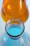 Duas garrafas com cores dos líquidos Fotos de Stock Royalty Free