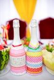 Duas garrafas do champanhe na tabela brilhante Foto de Stock Royalty Free
