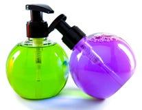 Duas garrafas pequenas cosm?ticas da cor brilhante Foto de Stock Royalty Free