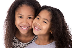 Duas irmãs no fundo branco Foto de Stock Royalty Free