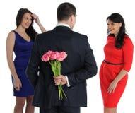 Duas jovens mulheres e um homossexual Fotografia de Stock