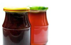 Duas latas do marmelade imagens de stock