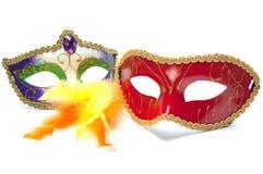 Duas máscaras e penas do carnaval Imagens de Stock