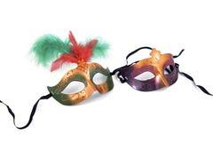 Duas máscaras no branco Fotografia de Stock