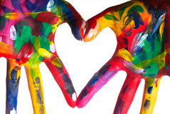 Duas mãos coloridas que dão forma a um coração V1 Foto de Stock Royalty Free