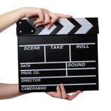 Duas mãos com um fim da placa de válvula do filme fotografia de stock royalty free