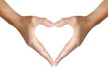 Duas mãos fazem a forma do coração no branco Foto de Stock