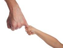 Duas mãos: homem e criança imagem de stock royalty free