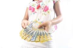 Duas mãos prendendo montões de dólares australianos Fotografia de Stock Royalty Free