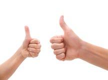 Duas mãos que fazem os polegares levantam o gesto Fotografia de Stock