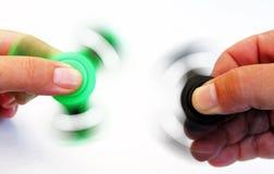 Duas mãos que guardam giradores de giro da inquietação Foto de Stock Royalty Free