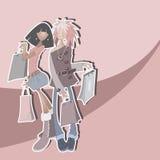Duas meninas à moda com compra Foto de Stock