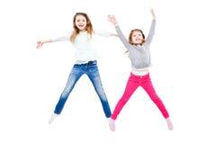 Duas meninas alegres em um salto fotos de stock royalty free