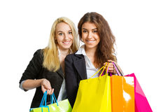 Duas meninas com sacos de compras Imagem de Stock Royalty Free