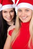 Duas meninas do Natal feliz isoladas Foto de Stock Royalty Free