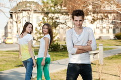 Duas meninas e um menino Imagens de Stock