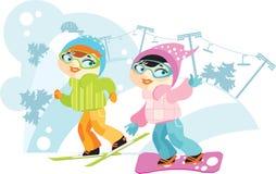 Duas meninas em esquis e em snowboard Foto de Stock Royalty Free