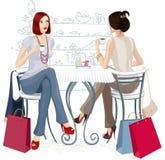 Duas meninas em um café Fotos de Stock Royalty Free