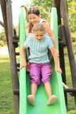 Duas meninas felizes em uma corrediça Imagem de Stock Royalty Free