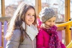 Duas meninas no campo de jogos Foto de Stock Royalty Free